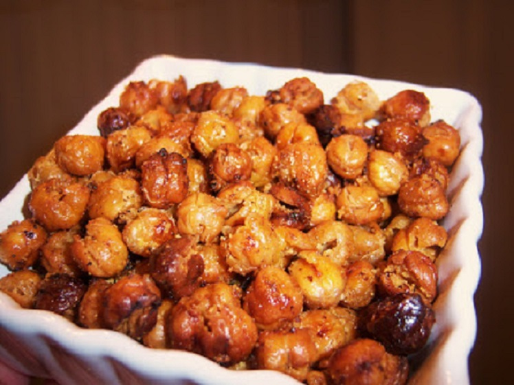 These are chickpeas otherwise known as garbanzo beans, roasted in the oven with garlic and spice. Seasonings have coated the outside  the chickpeas with the addition of oil . They are roasted.