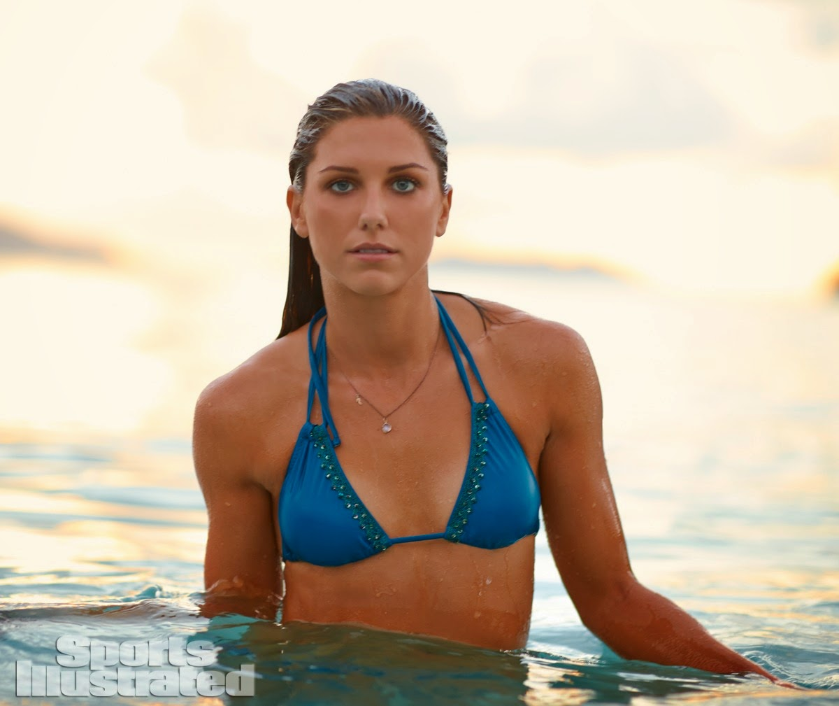 US Soccer Player Alex Morgan shows off bikini looks for the Sports Illustrated 2014 Swimsuit Issue
