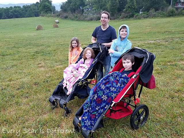 The family up bright and early to watch hot air balloons take flight.