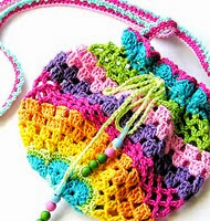 http://www.ravelry.com/patterns/library/rainbow-collection---purse