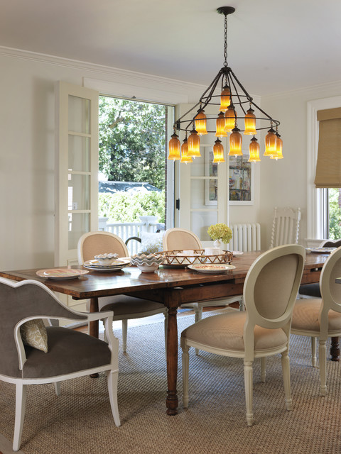 Traditional Details on the Wooden Dining Room Tables And Chairs under the Iron Chandelier on White Ceiling