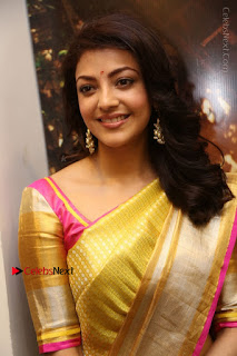 Actress Kajal Agarwal Stills in Golden Silk Saree at Trisha Sesigner Store Launch  0007.jpg