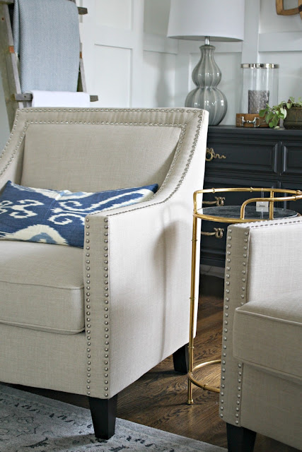 Neutral arm chair with nailhead trim