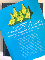 Handbook of Mathematical Functions with Formulas, Graphs, and Mathematical Tables, by Abramowitz and Stegun, superimposed on Intermediate Physics for Medicine and Biology.