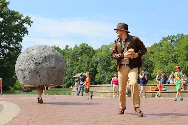 Indiana Jones chased by a rock cosplay