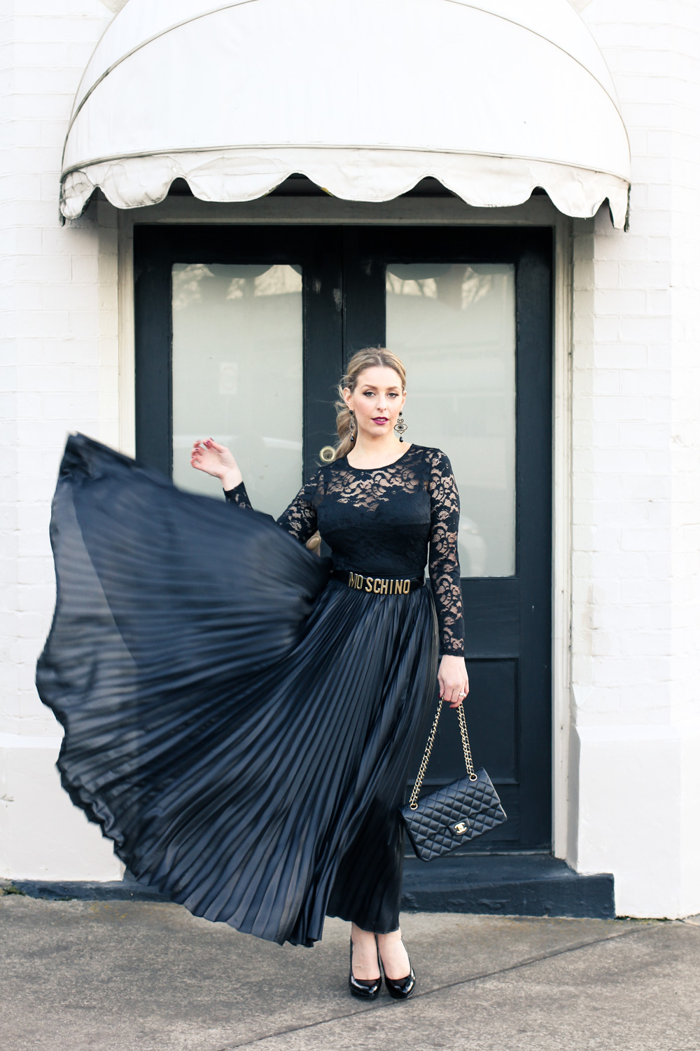 Goldfields Girl styling all black pleated maxi skirt, Moschino belt and Chanel bag