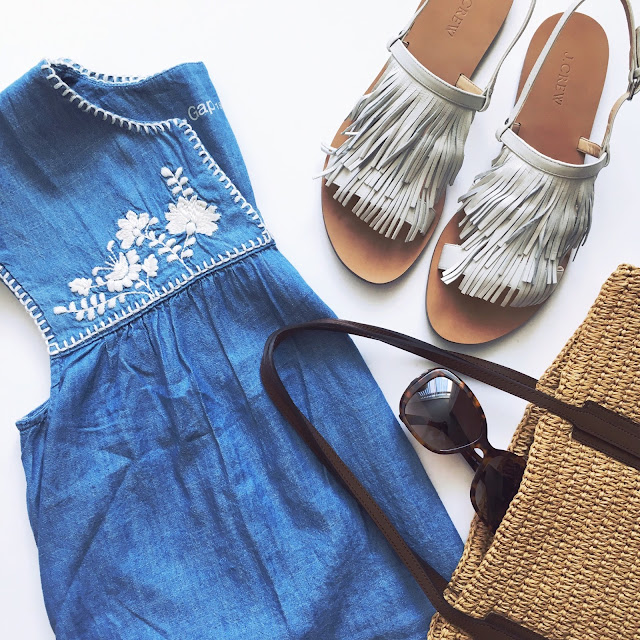 Embroidered chambray top, white leather fringe sandals, Versace sunglasses and straw tote bag