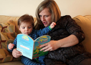 Image: Lynne Adams reads a story to her little boy, Anderson Adams, before bedtime. Lynne is now pregnant with her second child.