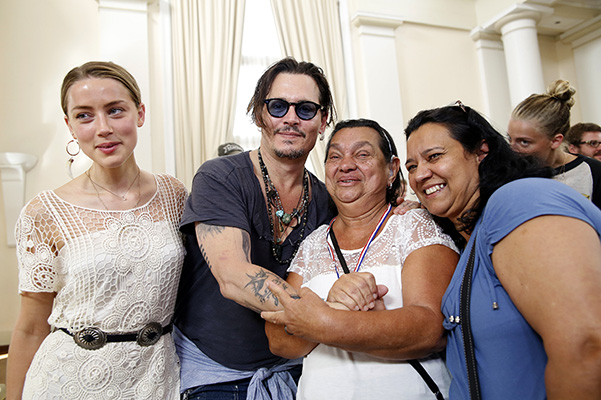 Amber heard and johnny Depp a charity event for people with hearing problems