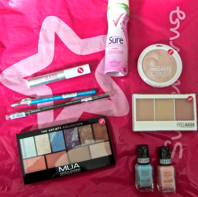 A picture of products bought in Superdrug such as Barry M nail varnish, MUA and Sure deodrant