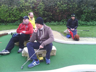 Midlands Minigolf Club members 'Squire' Richard Gottfried, 'Hacksaw' Jon Drexler, Mark 'The Horse Whisperer' Swan and John 'Thighs' Moore relax at the course in Basingstoke in 2013
