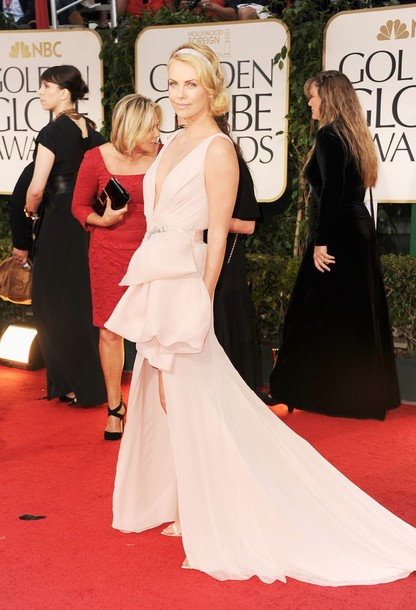 f0a18993deb61 Charlize Theron in Custom Christian Dior Haute Couture: It was no surprise  that Charlize made a jaw dropping entrance onto the Red Carpet or that she  wore ...