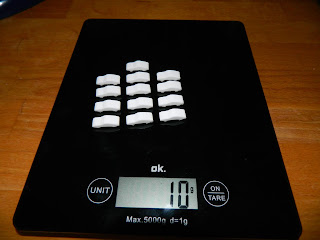 a bunch of Porsche mints lined up neatly on the kitchen scale