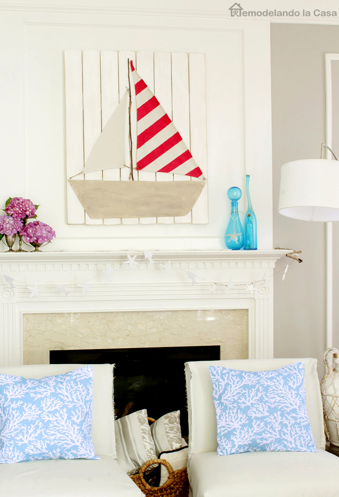 red striped sail boat art project mantel, pink hydrangeas, blue bottles