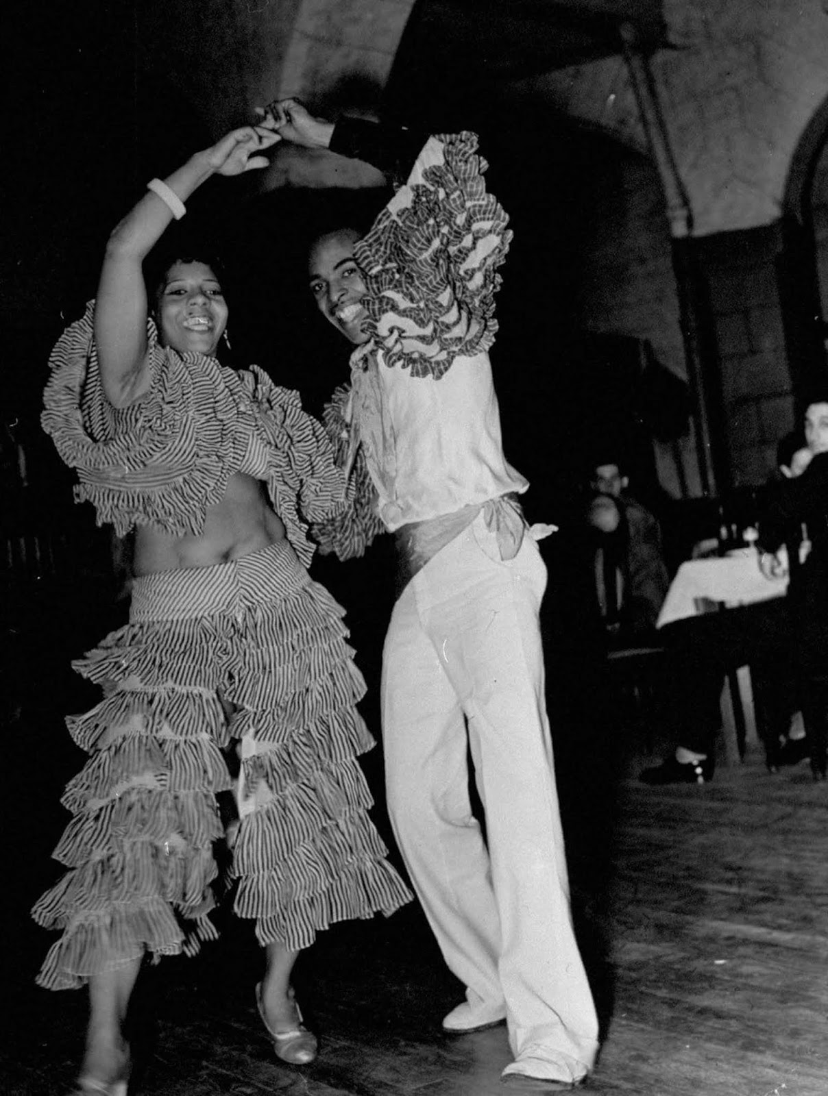 A view of people dancing at a Cuban club. 1937.
