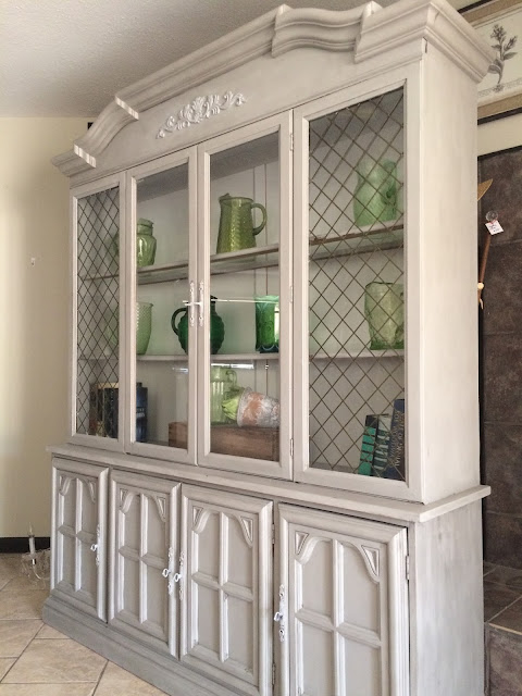 I love this cabinet staged with my Aunt's Green pitcher collection.