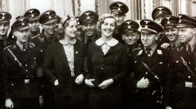 Unity Mitford (L) and her sister Lady Diana Mosley, nee Mitford (R) with SS troops at the September 1937 Nuremberg Party rally. The sisters were familiar faces in pre-war Germany.