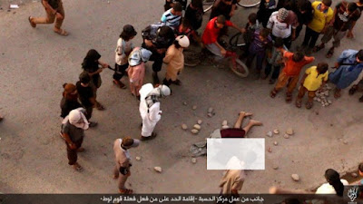 A gay man is being stoned to death after being thrown off a building top by ISIS militants in Kirkurk, Iraq, in July 2016.