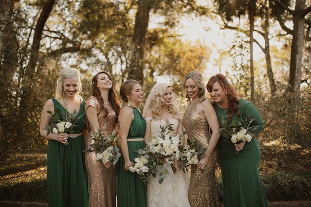 bridesmaids with green dresses and gold glitter dresses