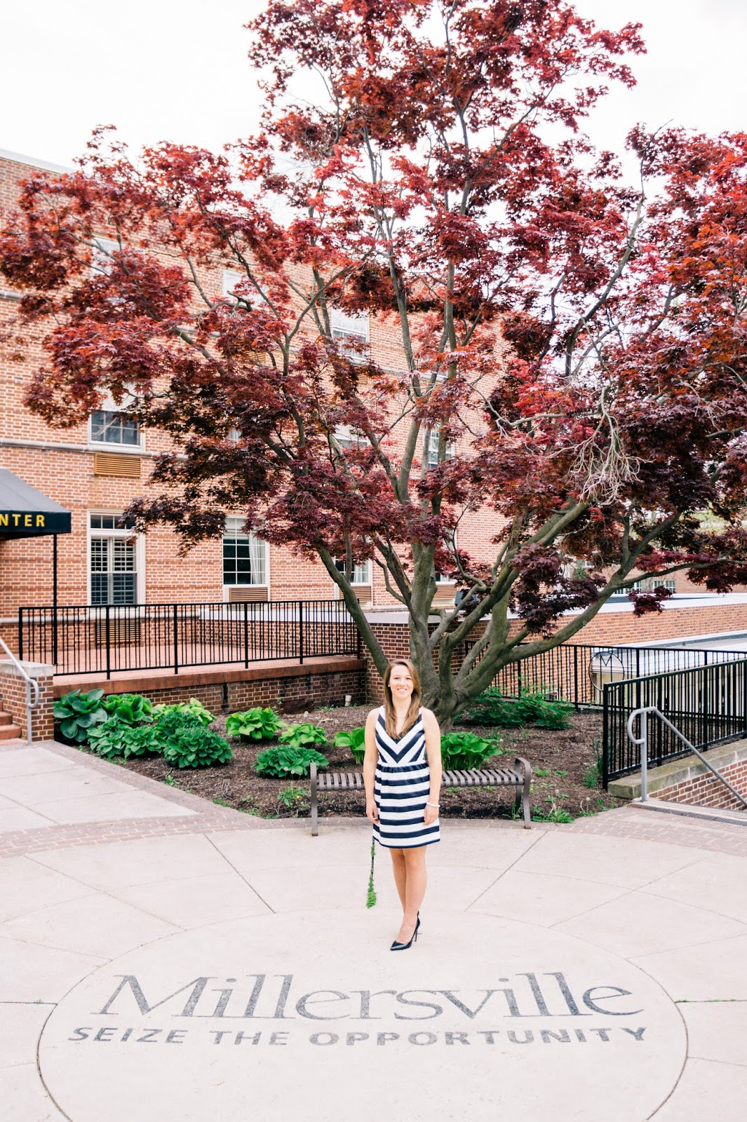 Girl in front of a red tree at Millersville University