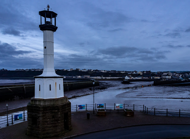 Photo of Maryport's old lighthouse just after sunset
