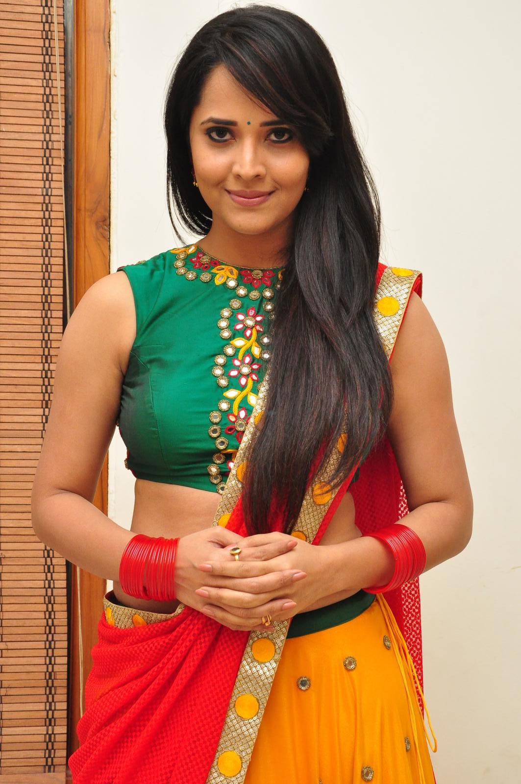 TV Anchor Anasuya In Yellow Half Saree At Telugu Film Audio Launch