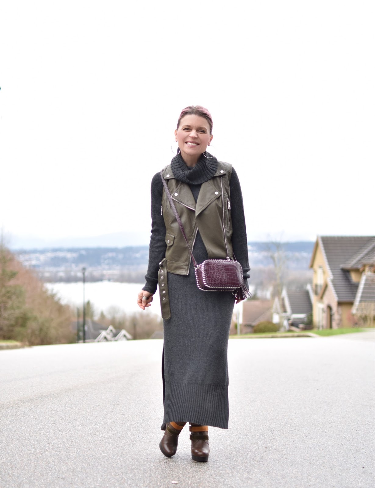 Monika Faulkner outfit inspiration - styling a turtleneck sweater dress with a moto vest and platform booties
