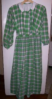 Green plaid dress, bishop sleeve, gauged skirt, gathered bodice.