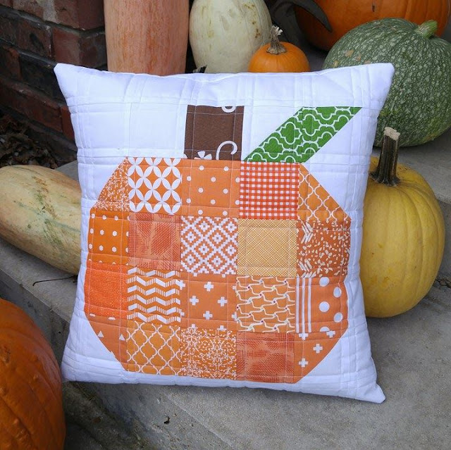 Scrappy patchwork pumpkin quilted pillow