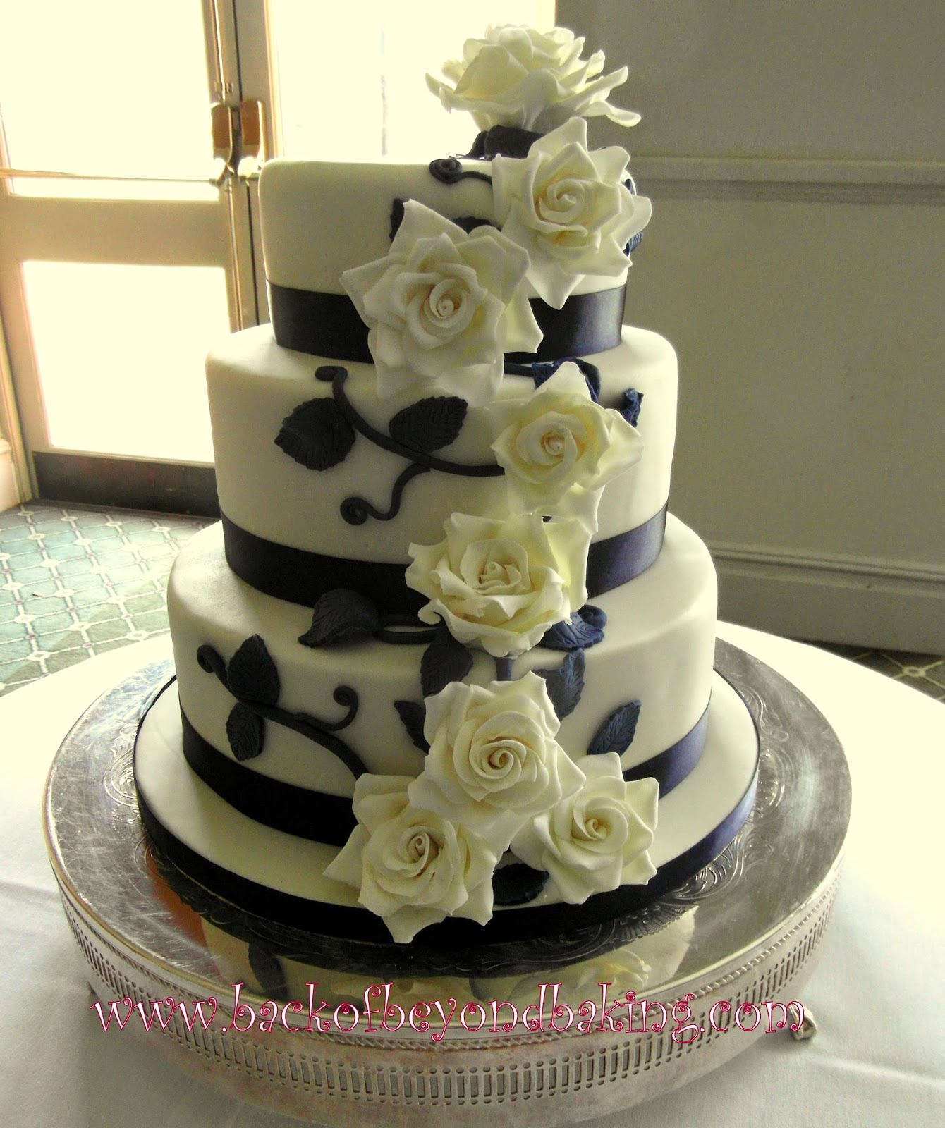 three tier navy and ivory wedding cake