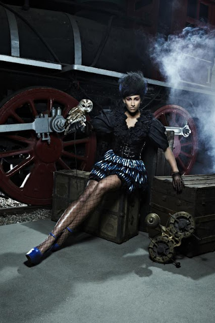ANTM steampunk fashion, steampunk clothing posing on train