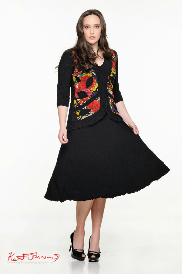Kathleen Berney Look Book SS 2013 - black textured full skirt dress with bright multi coloured vest. Photo by Kent Johnson.