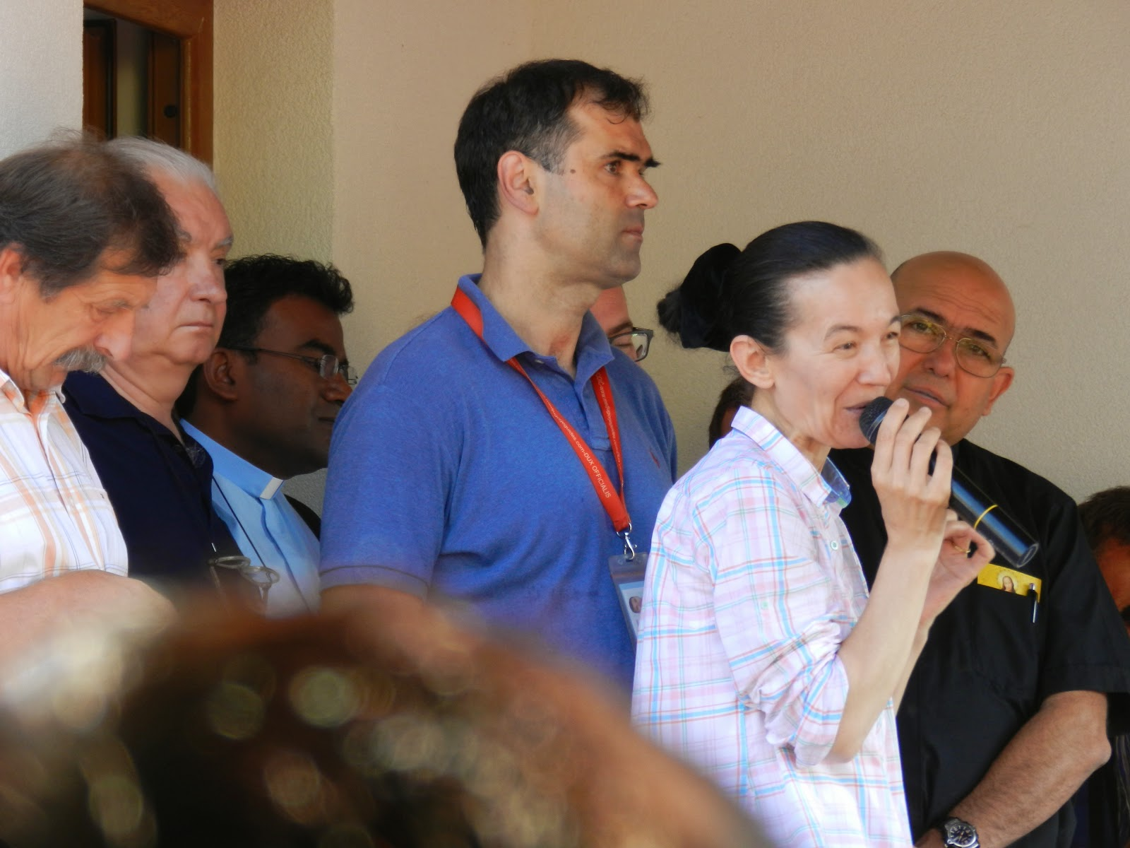 An image of the Medjugorje visionary Vicka in 2014, speaking to pilgrims.