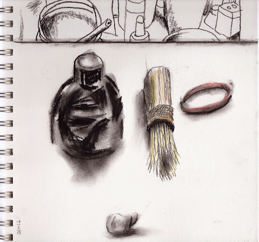Ink bottle, dad's shaving brush and rubber band on my desk