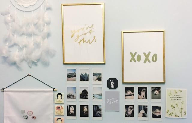 Framed gold foil prints on a wall