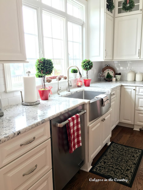 White Kitchen with farm sink in front of windows - decorated for Christmas