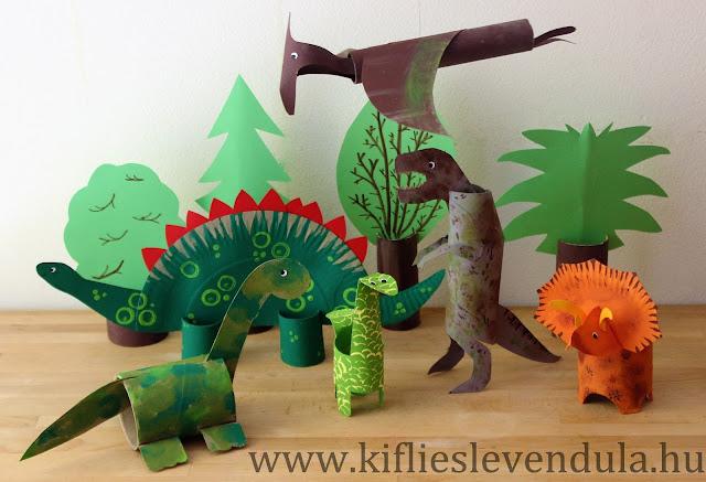 Varios dinosaurios creados con rollos de cartón