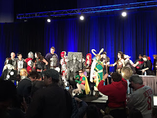 Photo of the winning and honorable mention cosplayers on stage after the costume contest.