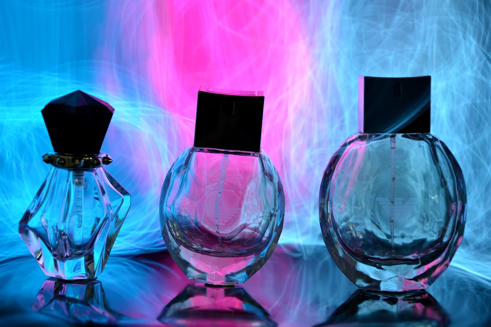 Paiting A Colourful Background with Lights Empty Perfume Bottles