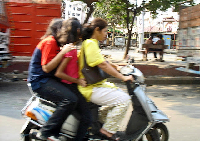 three girls on a scooter