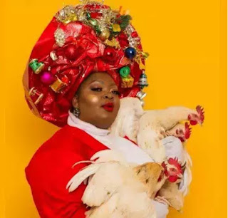Eniola Badmus Poses With Live Chickens In Christmas Shoot [Photos]