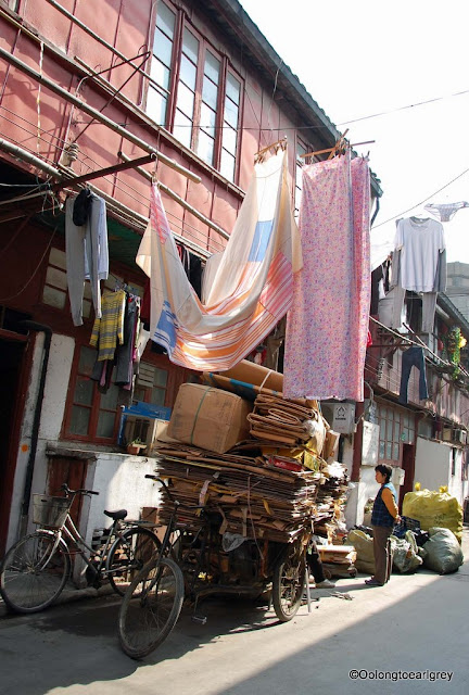 Laundry and load in an alley, Shanghai, China