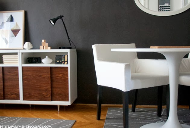 Mid century modern living and dining area with besta cabinet white docksta table gislev rug nils chairs and dark grey black walls - Petite Apartment
