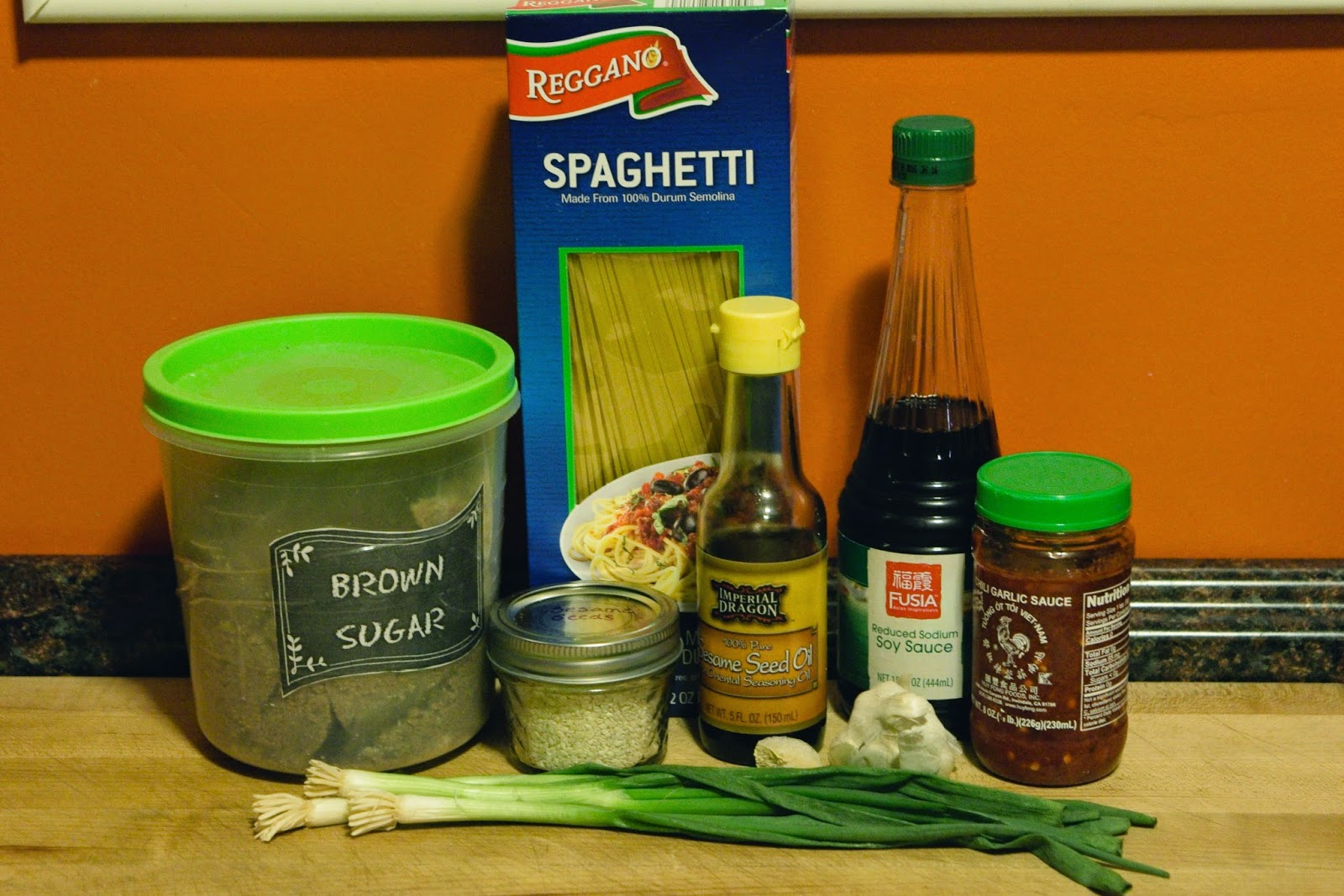 The ingredients used for making the homemade sesame noodles.