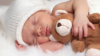 Baby_hug_teddy_bear_and_sleep_HD_image_free_download.jpg