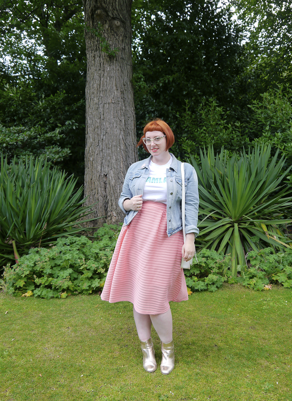 Scottish blogger wears Dreamland glitter tshirt, denim jacket, peach skirt and gold boots