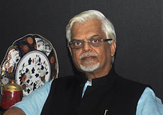 Manmohan's Advisor heaps praise on KTR