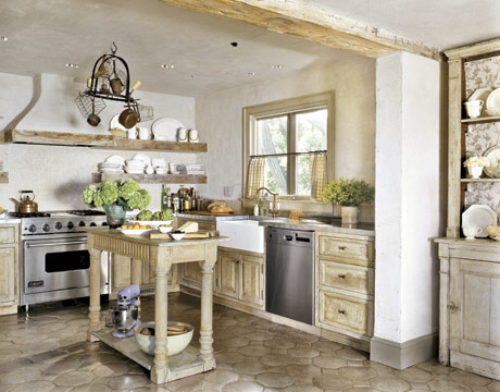 A wide open kitchen space feels warm and welcoming, and I love the wooden cabinets