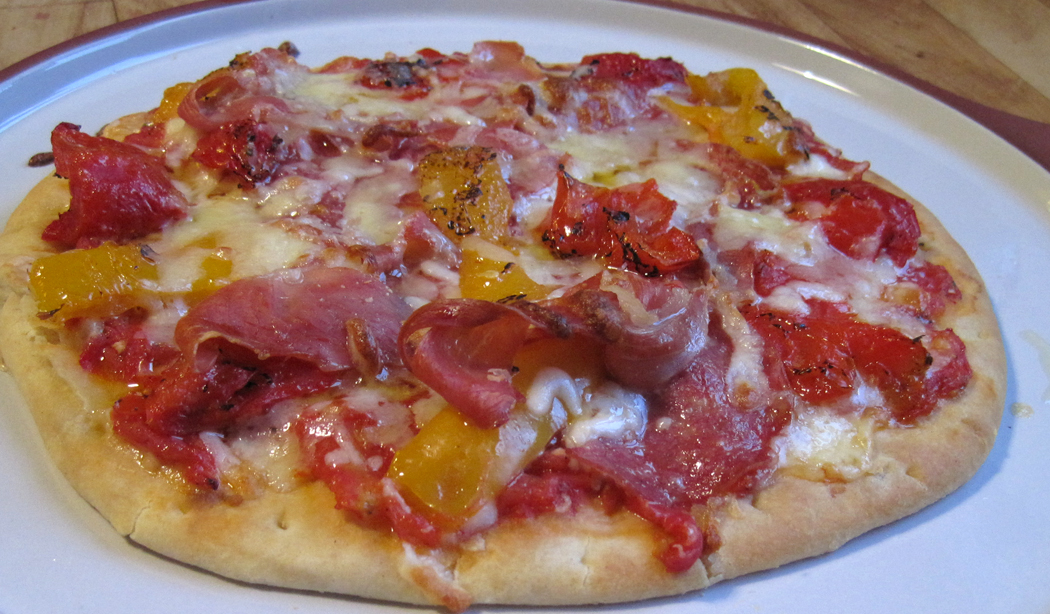 Prosciutto and Salami Pizza Topped with Sacla' Char-Grilled Peppers