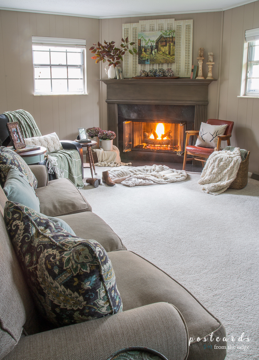 cozy family room with carpet and fireplace